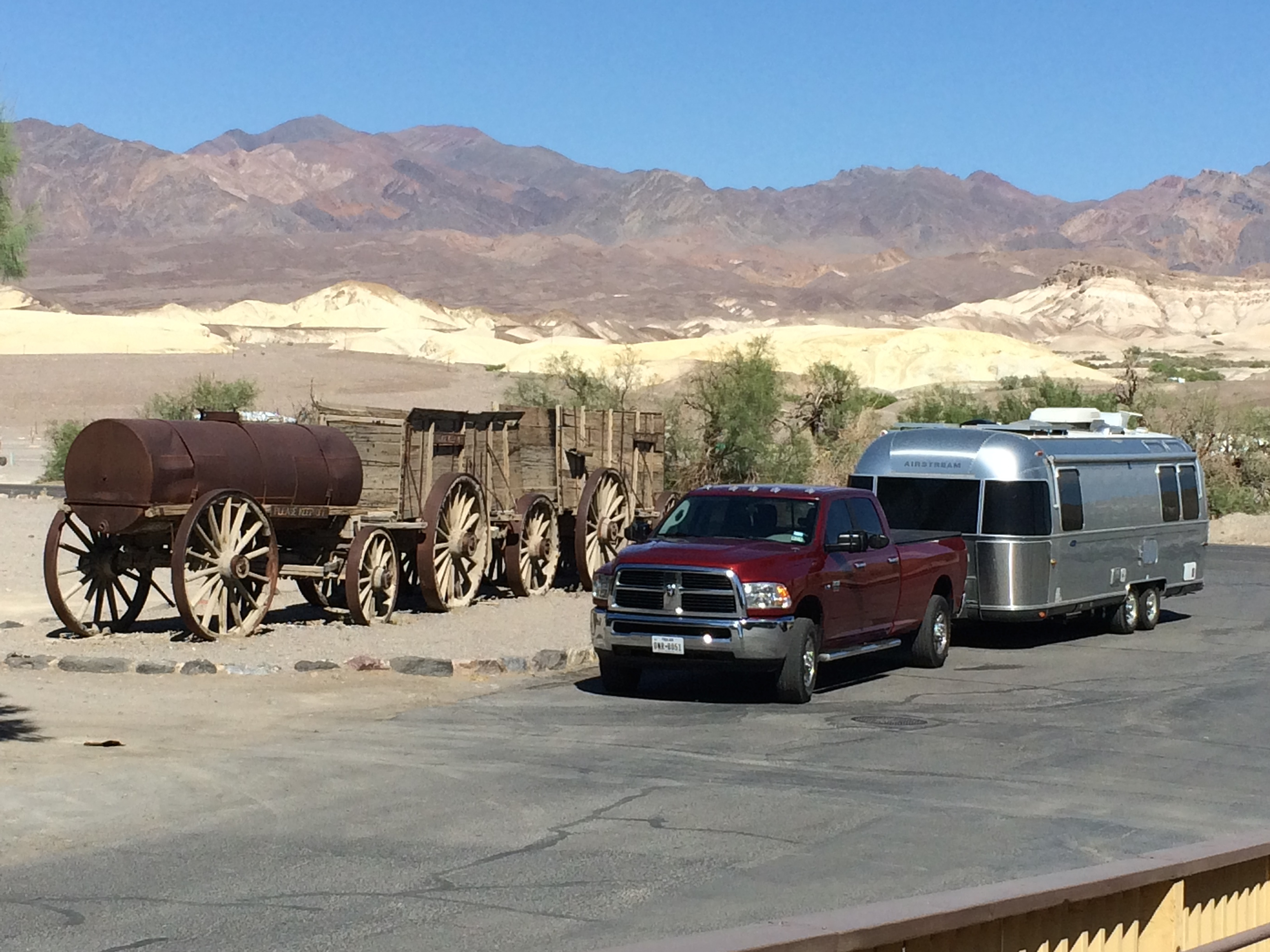 Bart and Flo posing next to the original Twenty Mule Team wagons  at Furnace Creek in Death Valley.