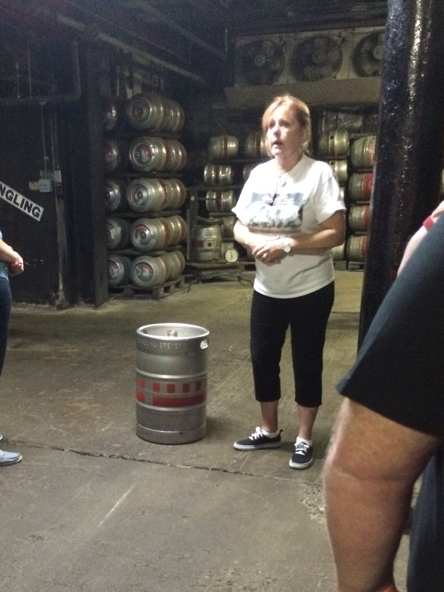 Sharon, the tour guide, with a modern keg