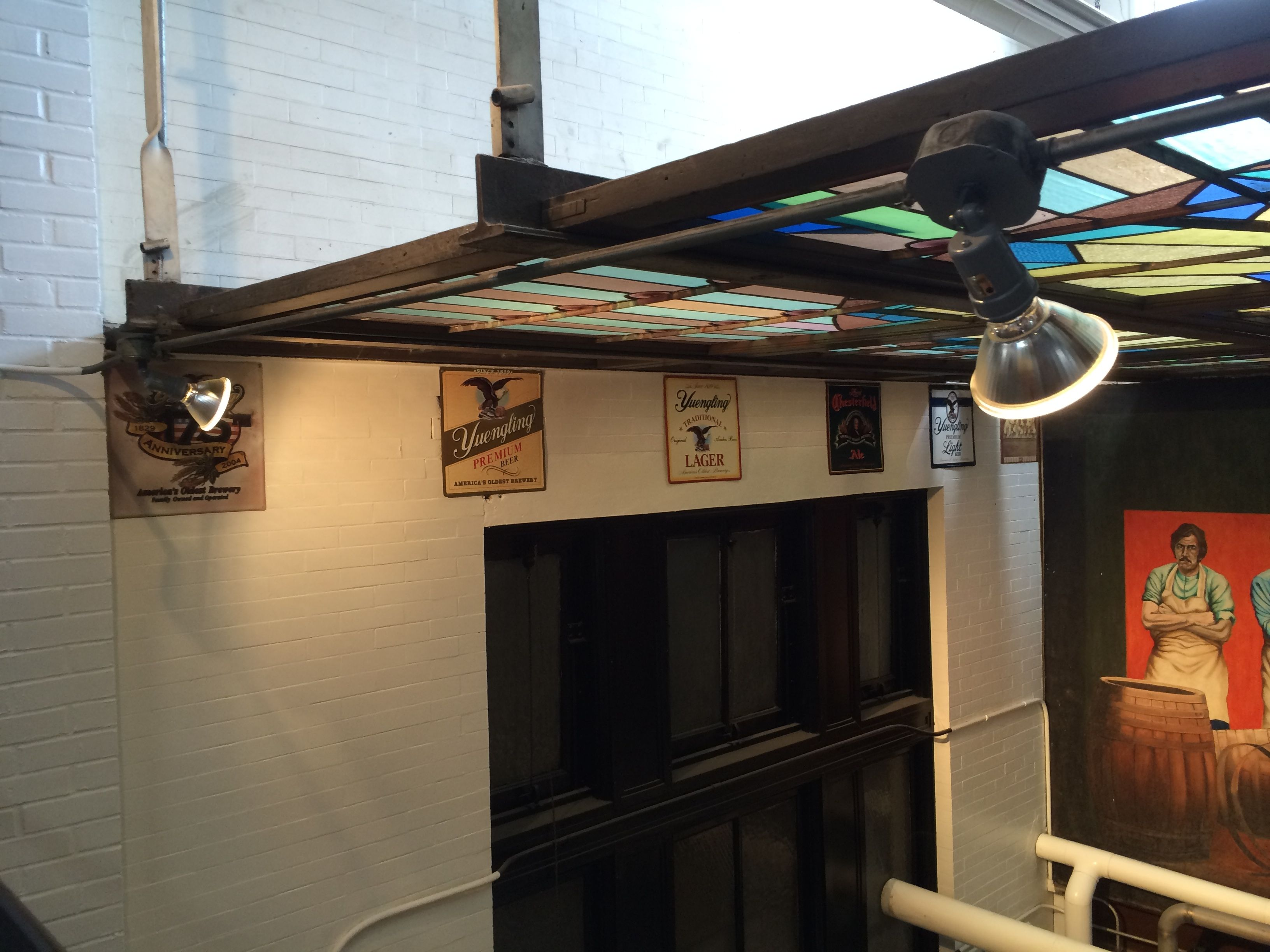 Stained glass window suspended under the skylight
