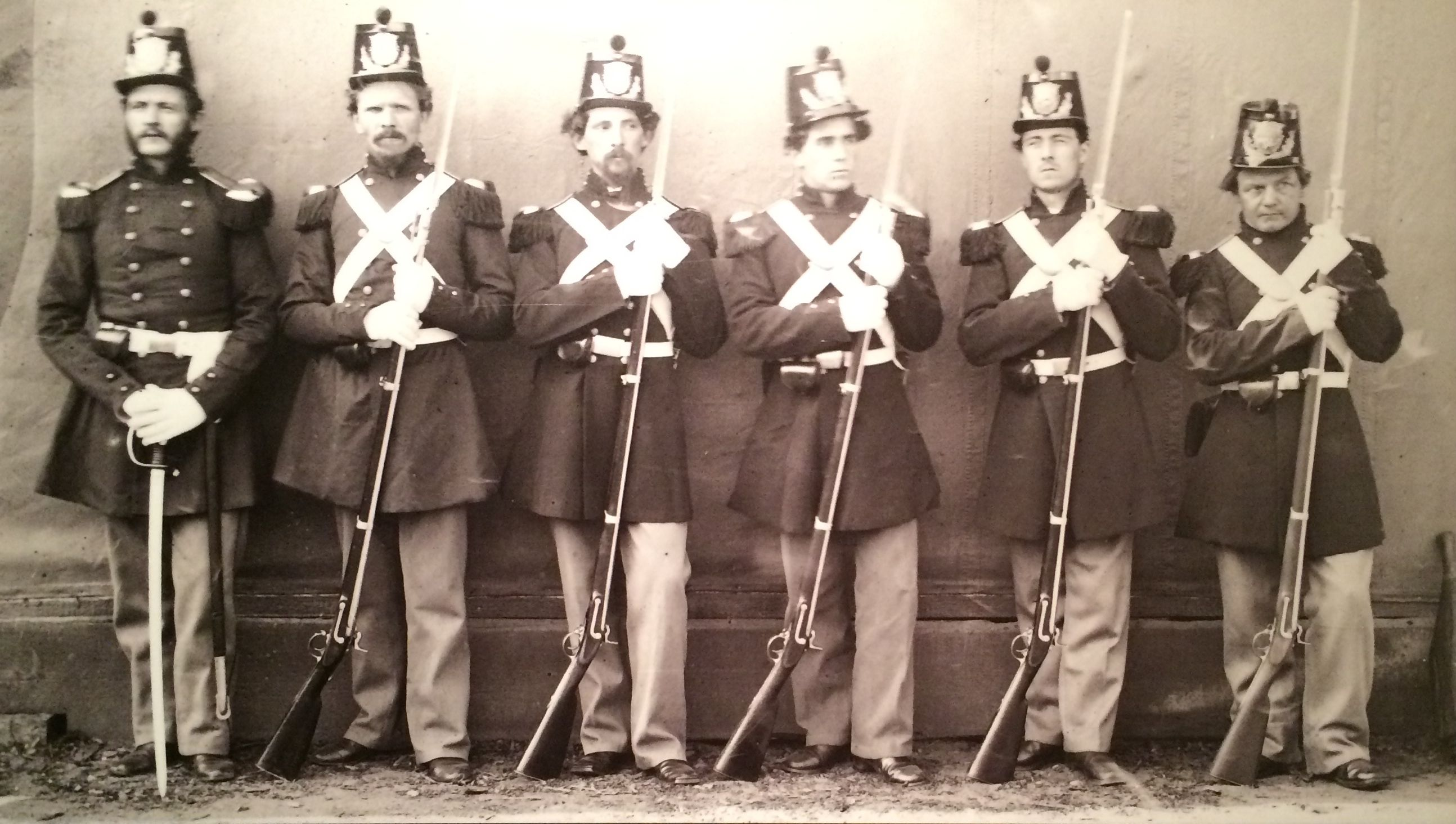 Officer and his men in drew uniform 1864