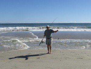 Surf fisher with fish