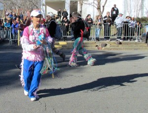 Marcher throwing beads