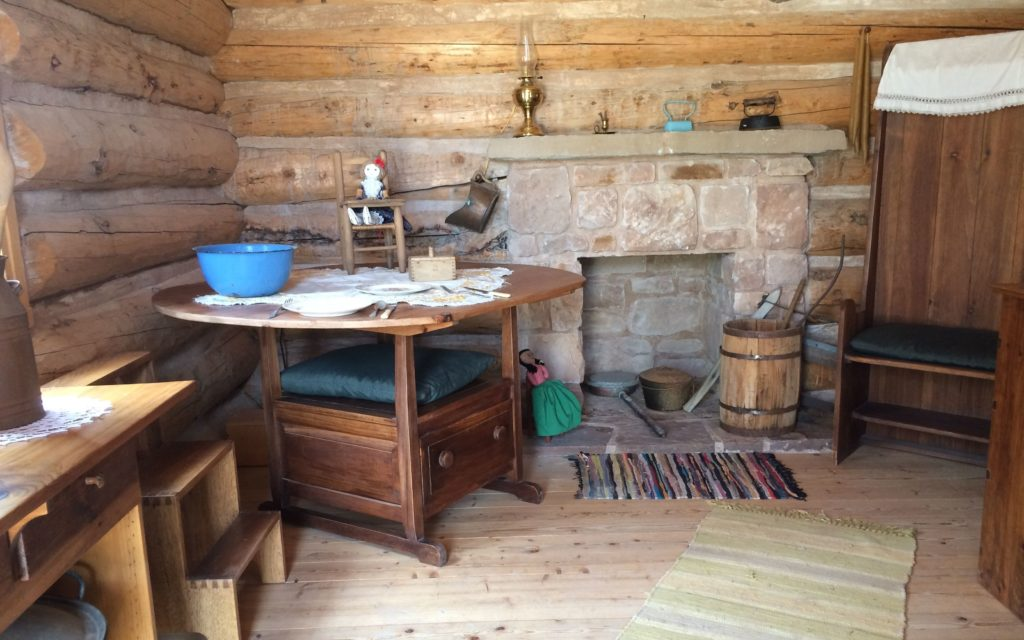 cabin with interesting storage in table