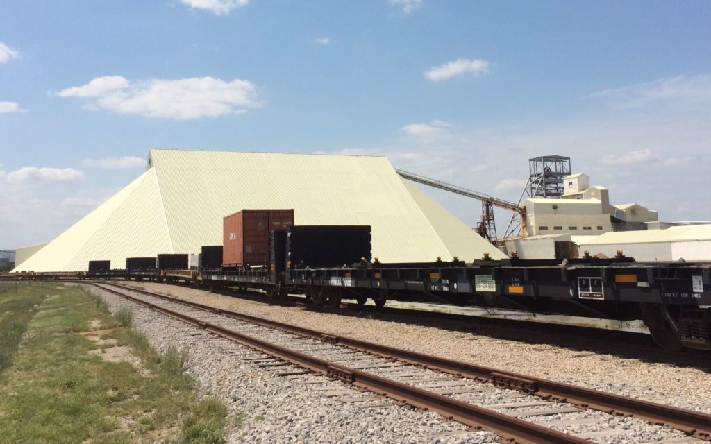 Salt storage shed with trains