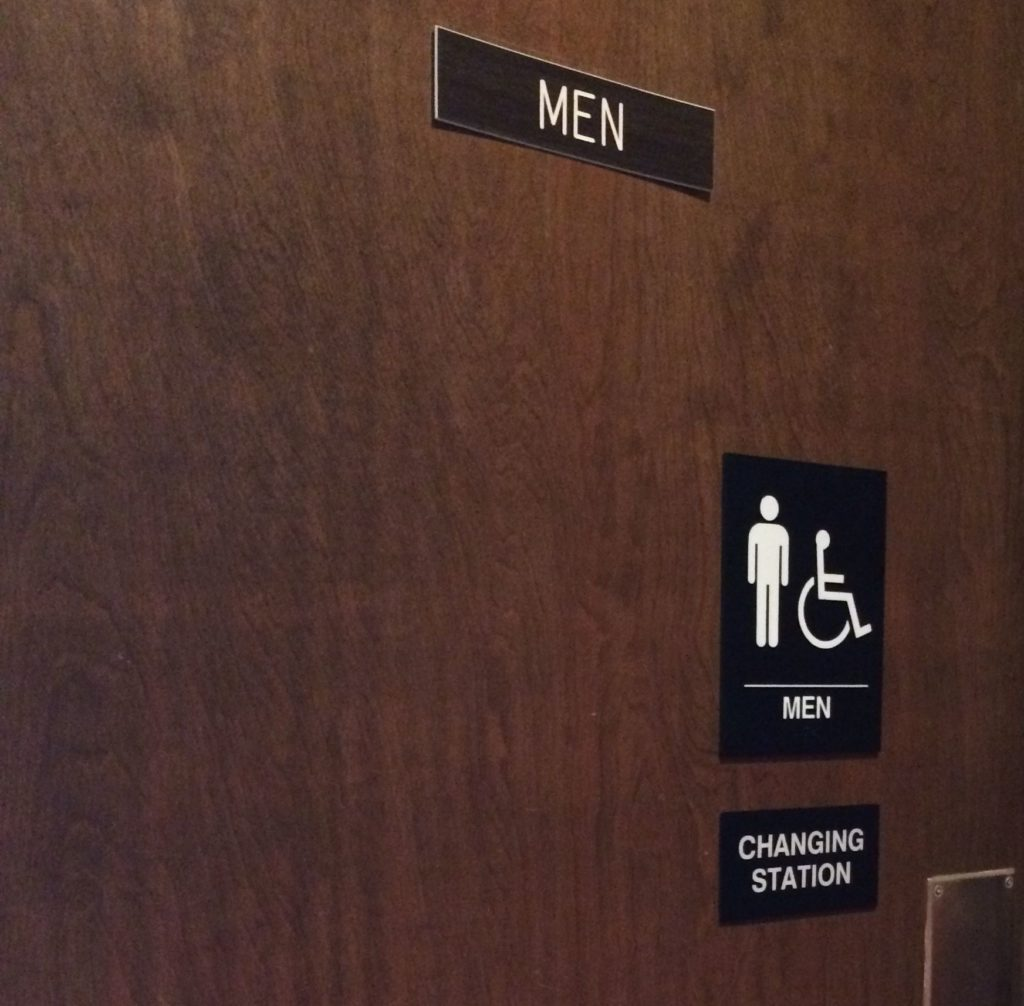 Mens room with changing station