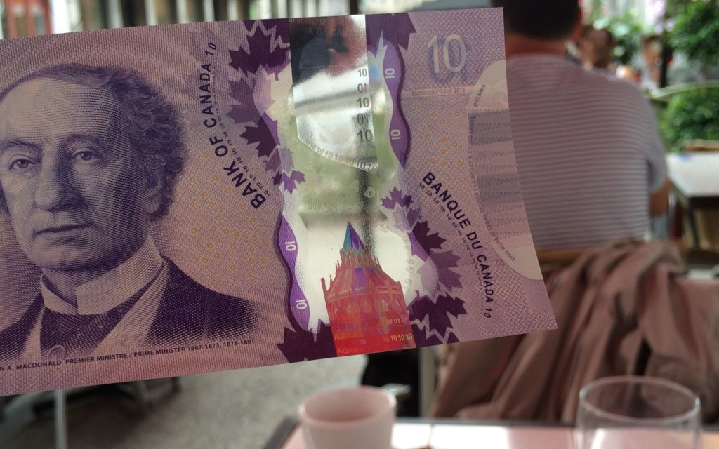 new Canadian money with a clear strip