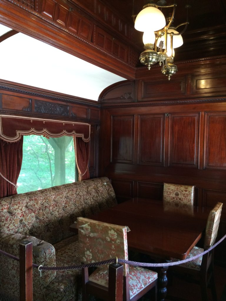 table and cahirs in rail car