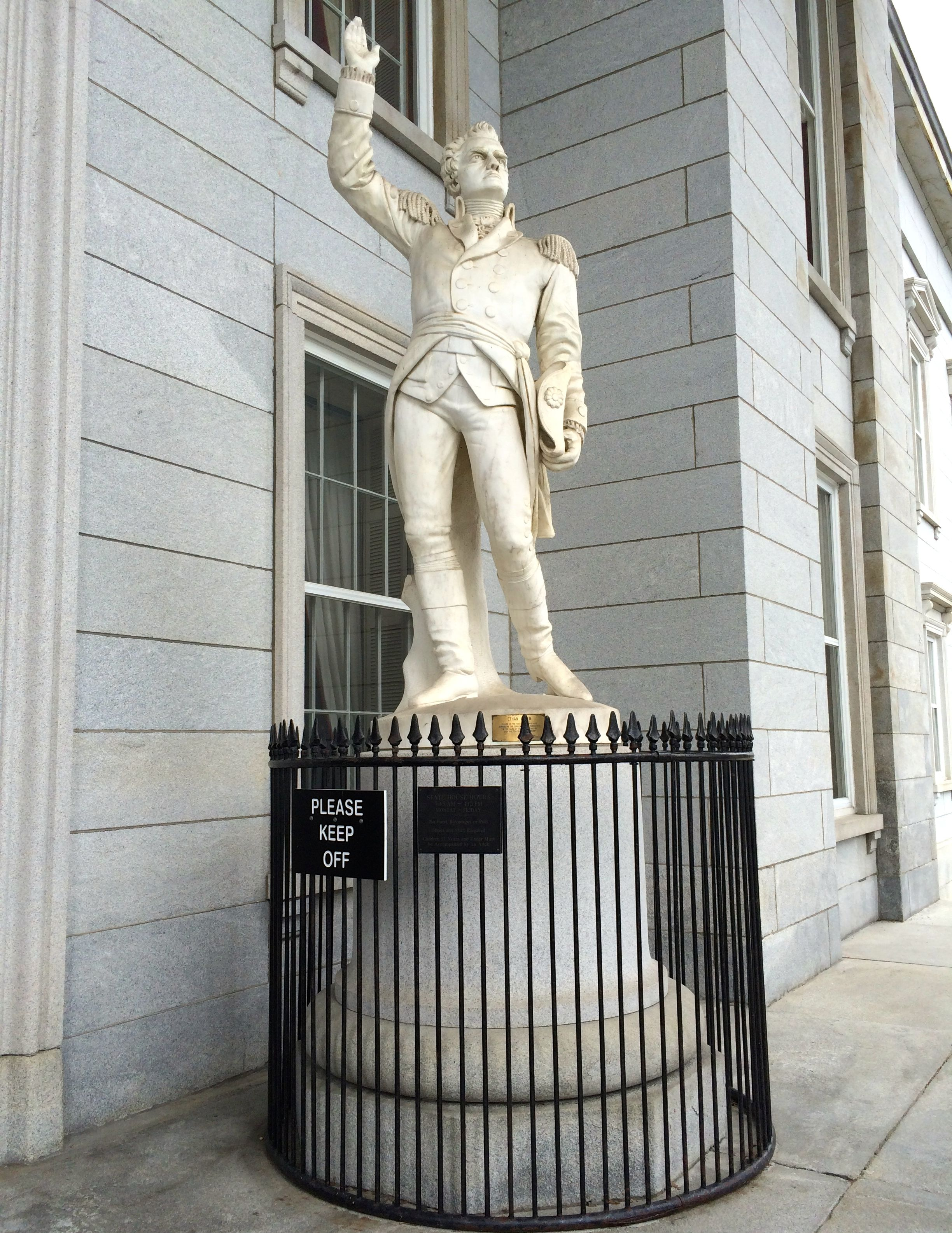 on the other side of the entrance is native son ethan allen patriot and real estate developer actually the guide told us that is was a fictionalized bennington ethan allen desk